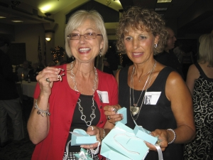 Garnette and Heike holding 'Flyers 1968' engraved Tiffany key rings for their work on the reunion committee.  There wa
